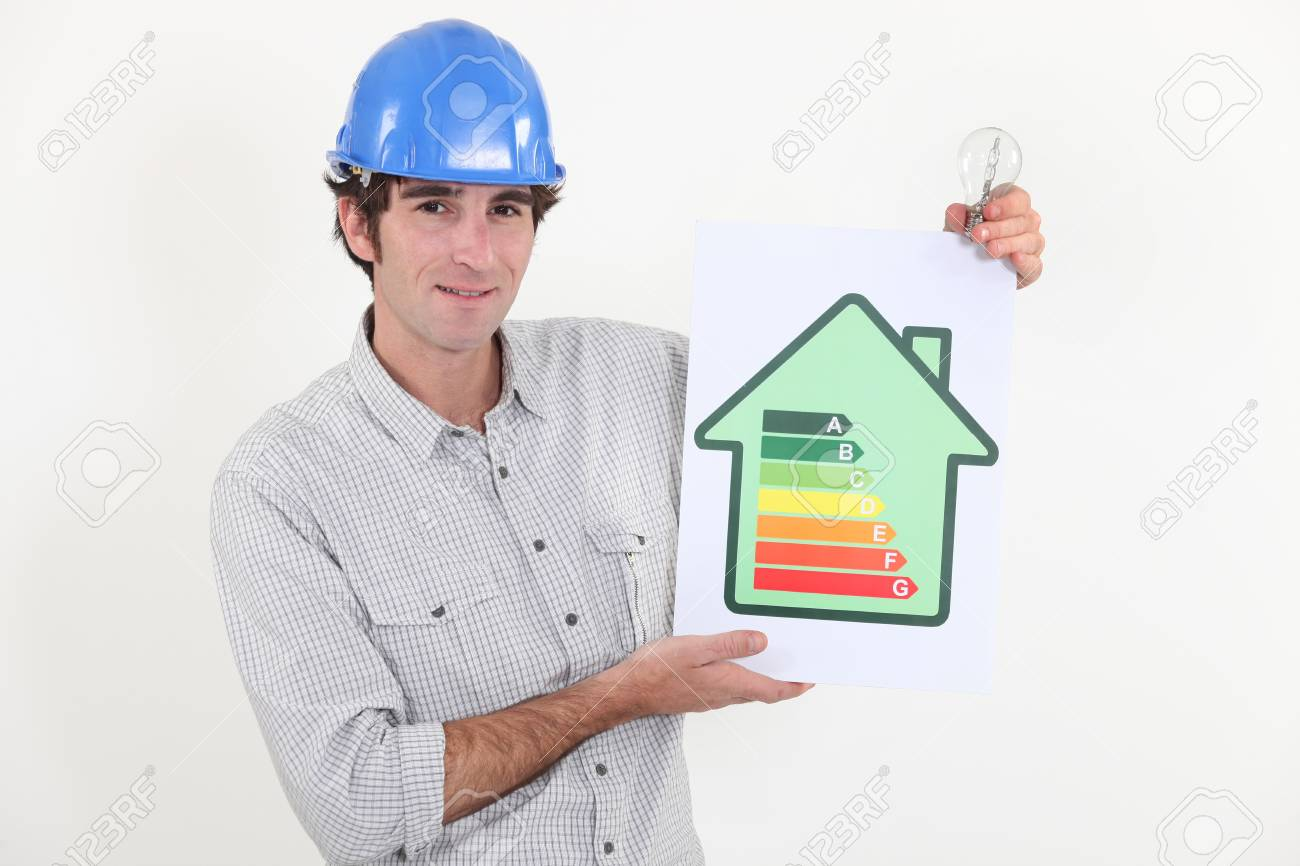 Constructor holding energy rating sign Stock Photo - 13868743