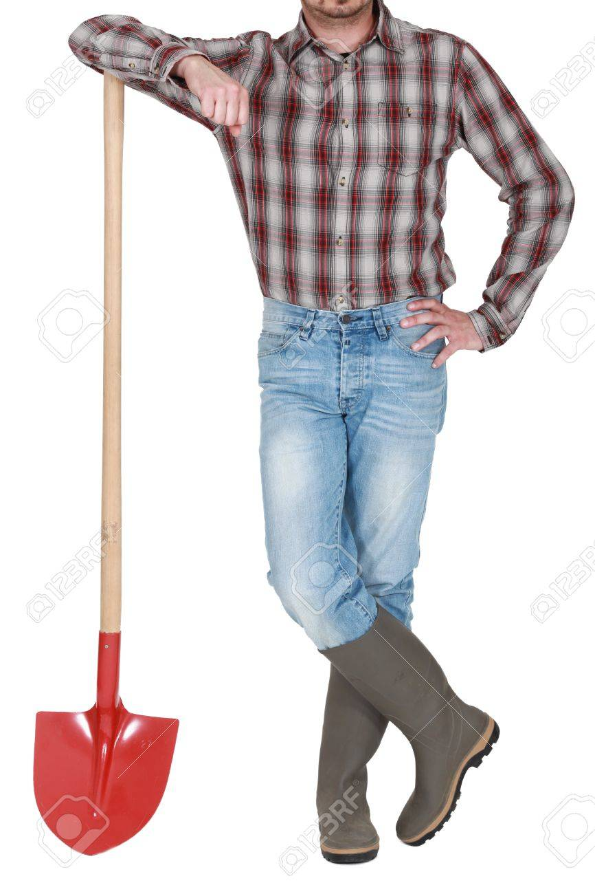 Craftsman Leaning On A Shovel Stock Photo