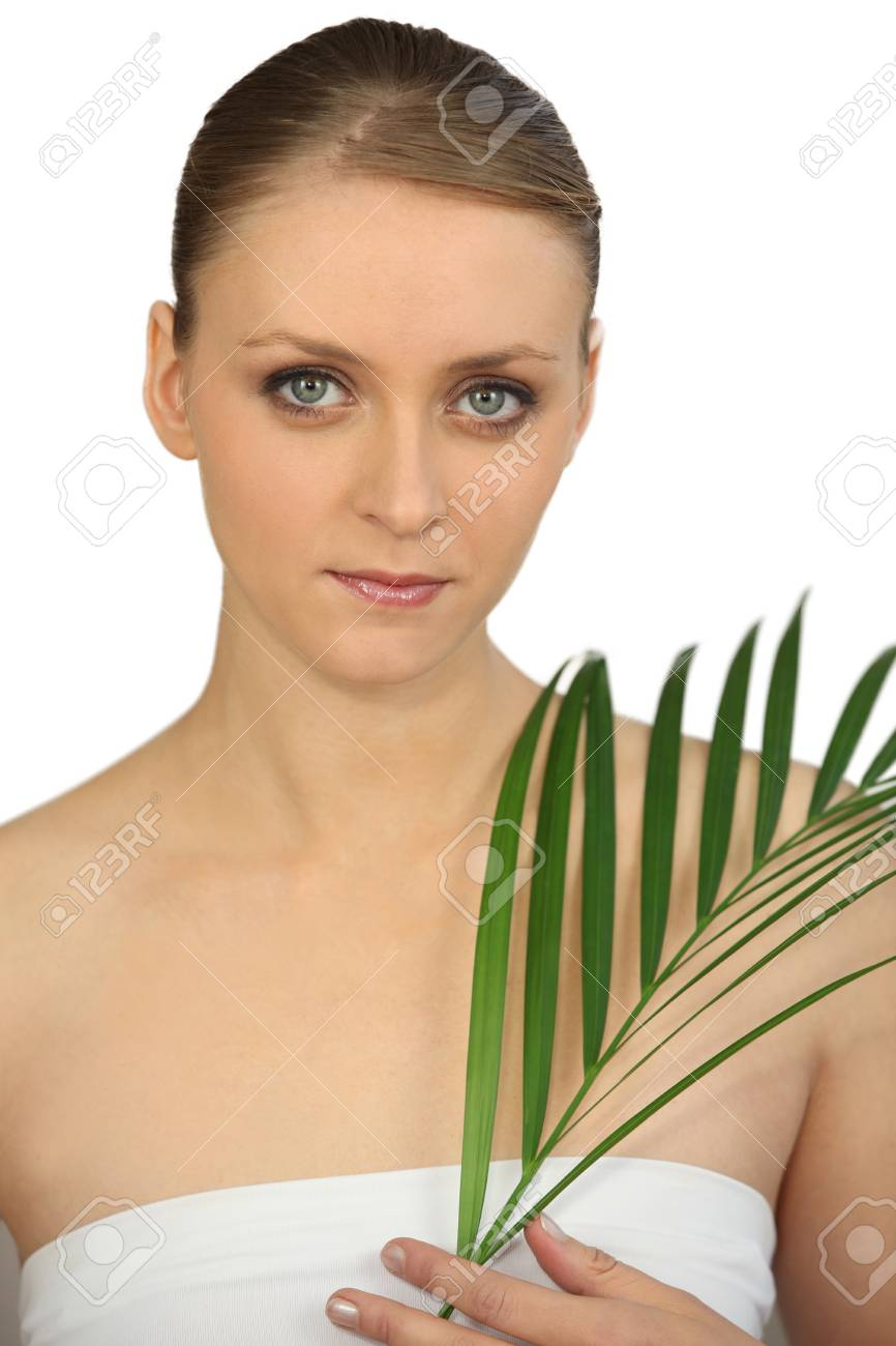 Woman holding a fern Stock Photo - 13875755