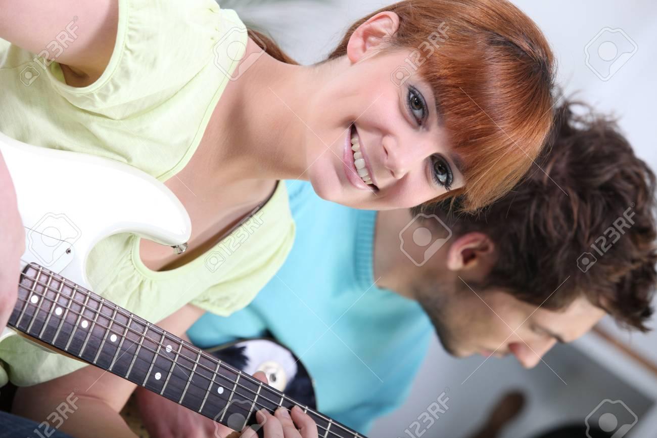 Horizontal image of girl with guitar Stock Photo - 13882491