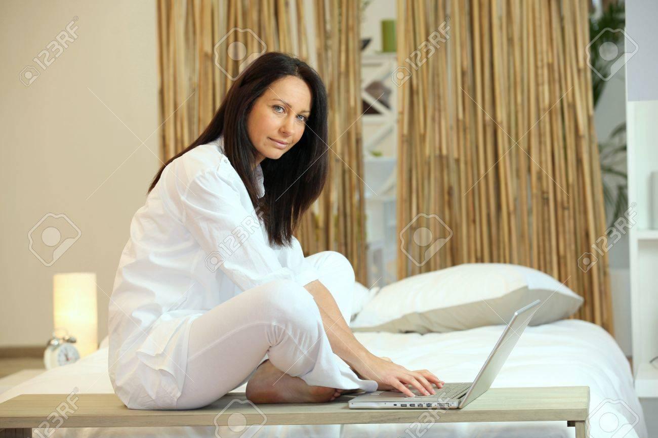 brunette working on laptop in Zen atmosphere Stock Photo - 13881935