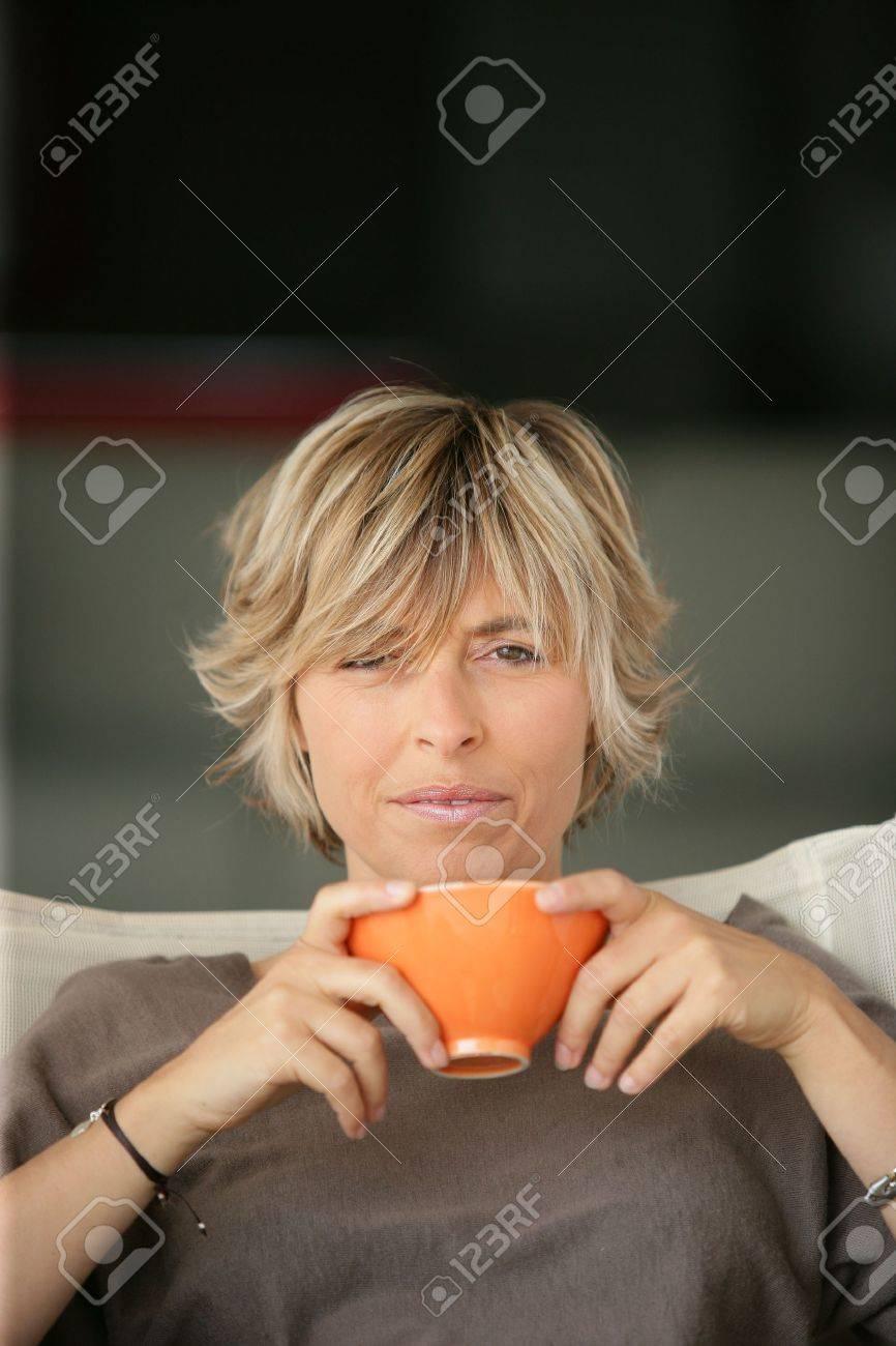 woman drinking tea on the sofa Stock Photo - 13880825