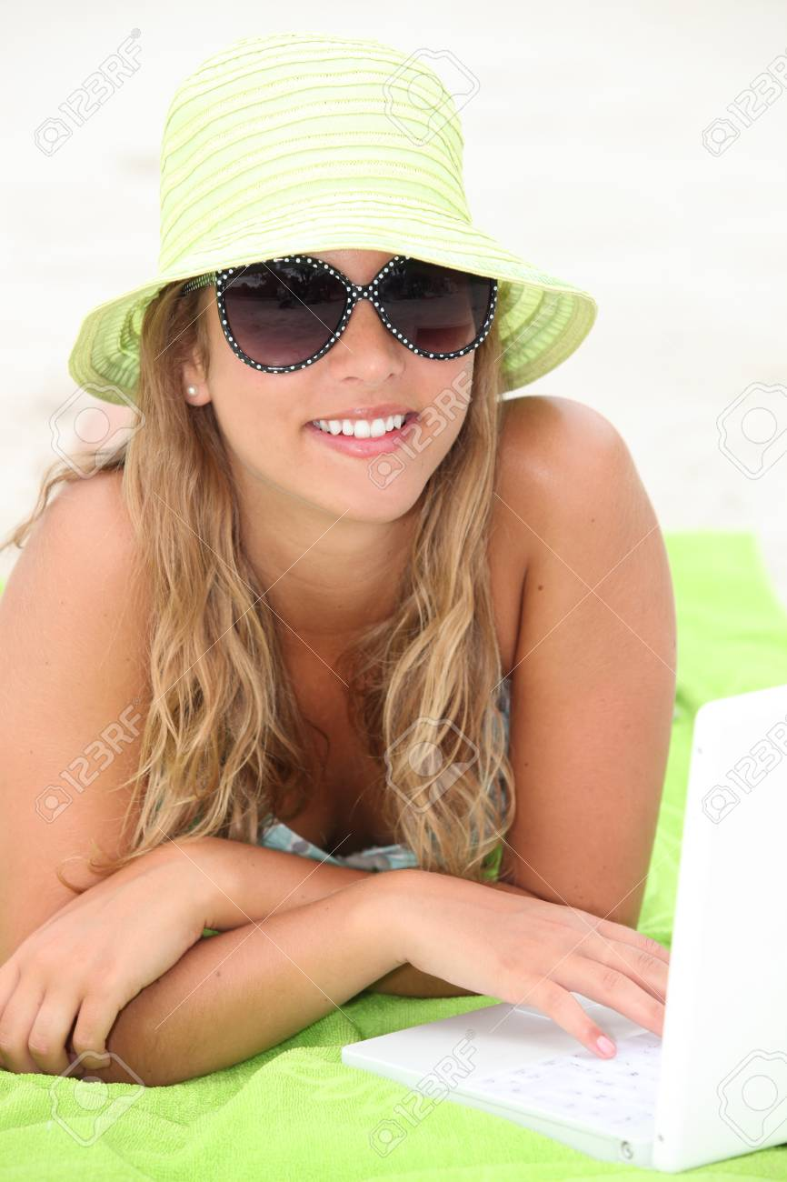Teen with hat on the beach Stock Photo - 13883453