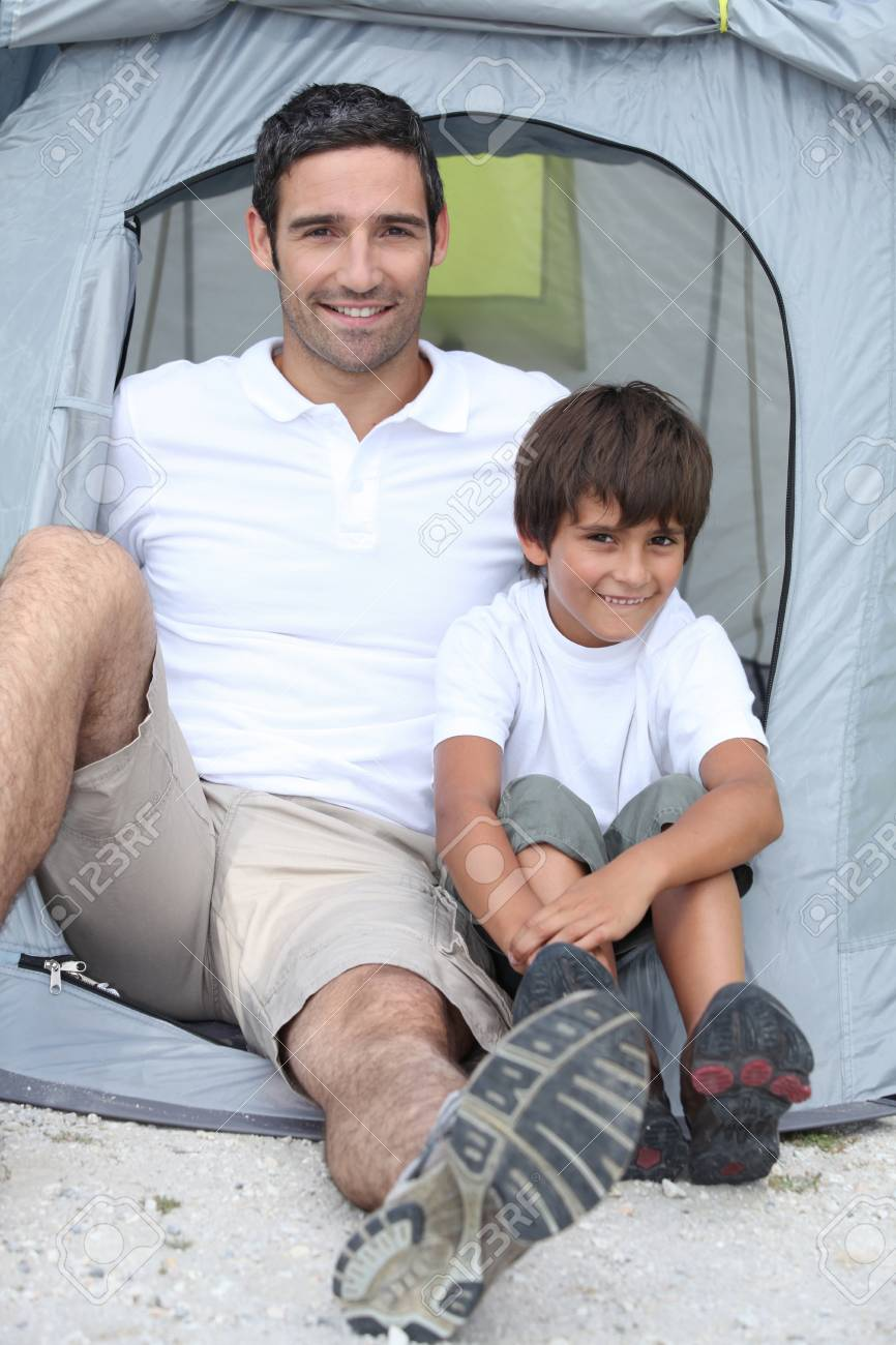 Father and son in front of tent Stock Photo - 13884356