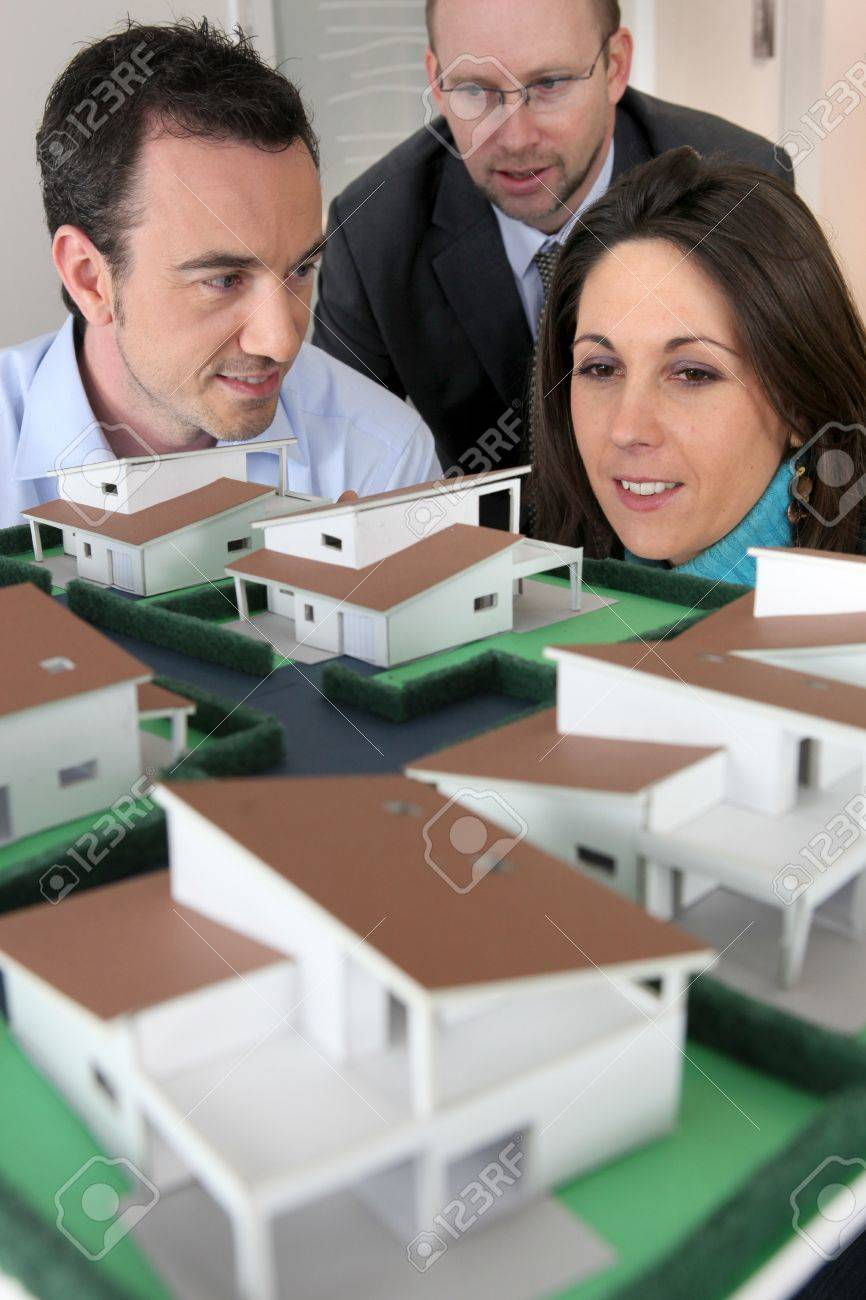 Architect showing scale model of house to buyers Stock Photo - 13904878