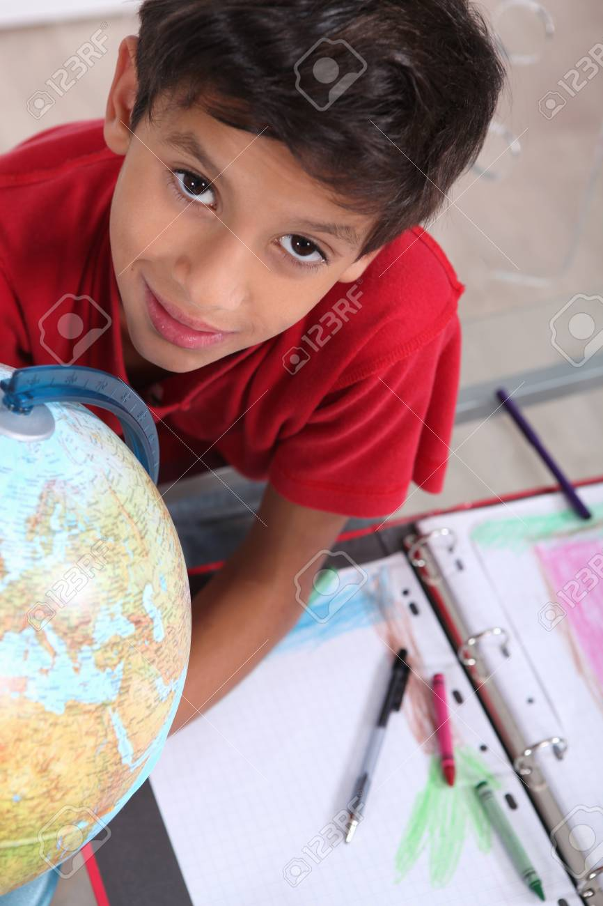 Boy dreaming of going around the world Stock Photo - 13962512