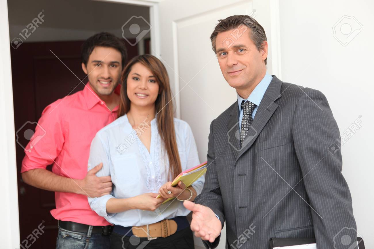 young couple and realtor Stock Photo - 13941482