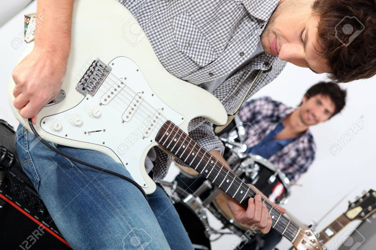 Landscape picture of guys with guitars and drums Stock Photo - 13941416