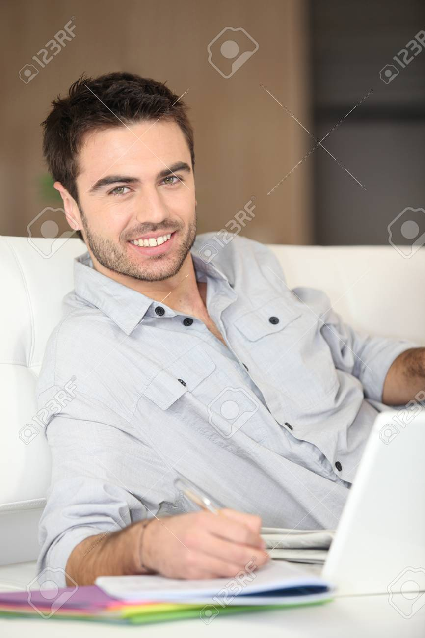 Man working from living room Stock Photo - 13961694