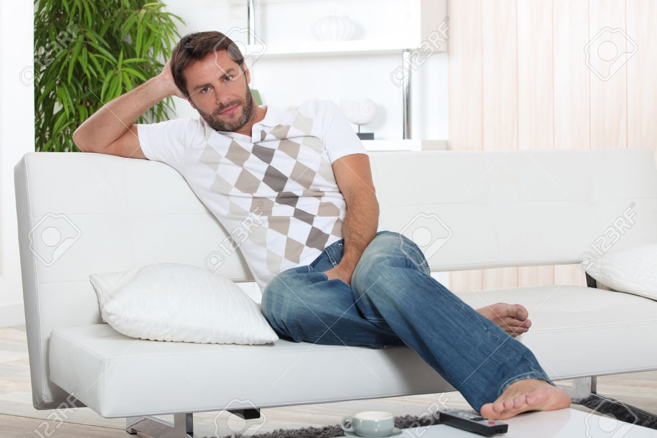 A Man Resting On His Sofa. Stock Photo, Picture And Royalty Free ...