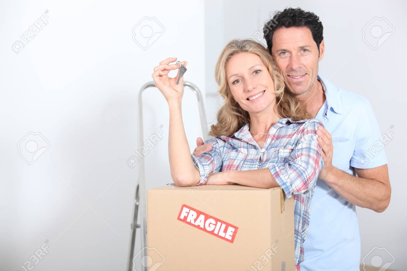 Couple with the keys of new flat Stock Photo - 14011354