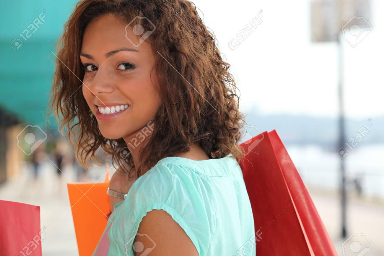 Woman enjoying lavish shopping trip Stock Photo - 14011356