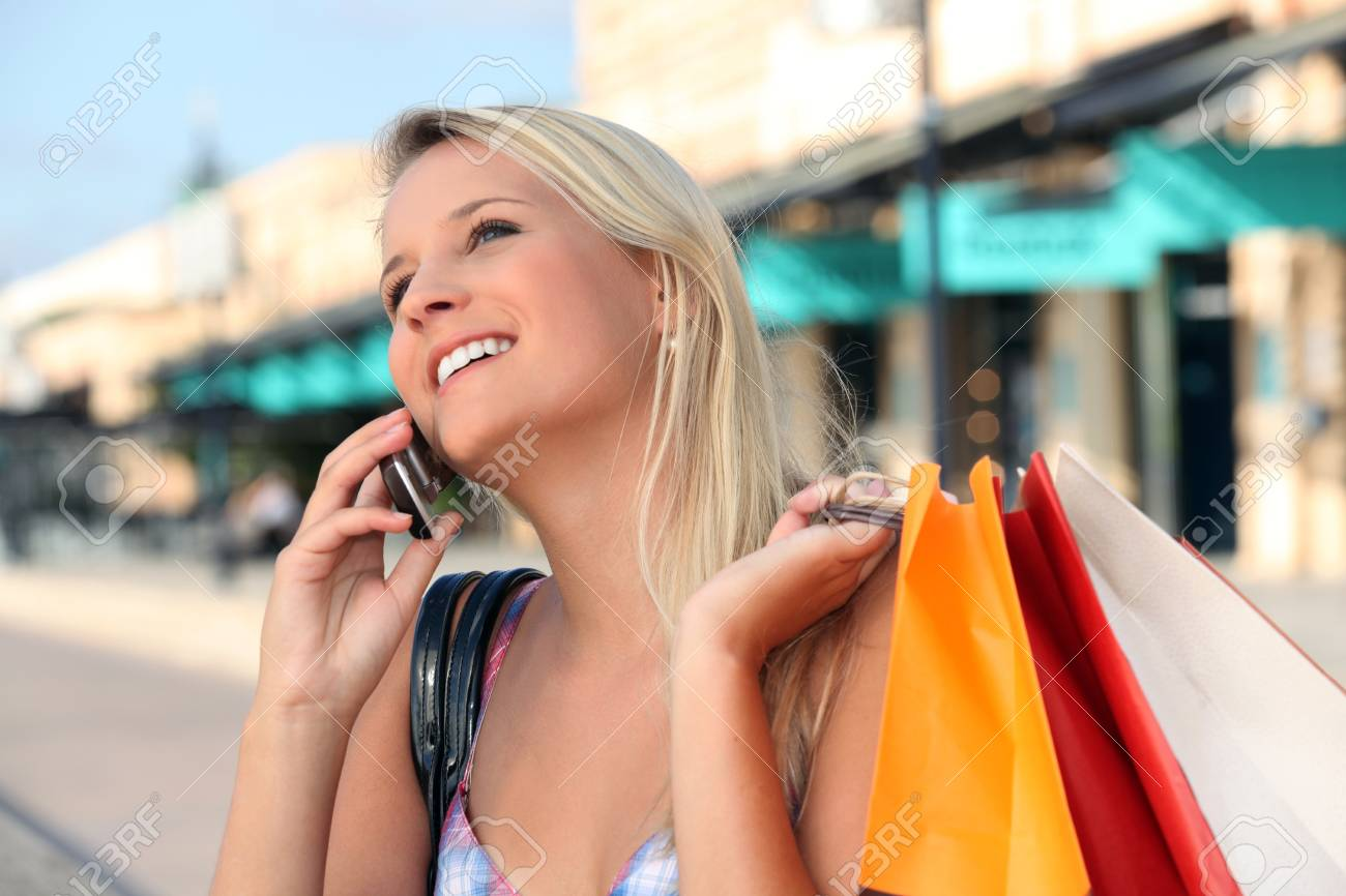 Blonde girl shopping Stock Photo - 14011342