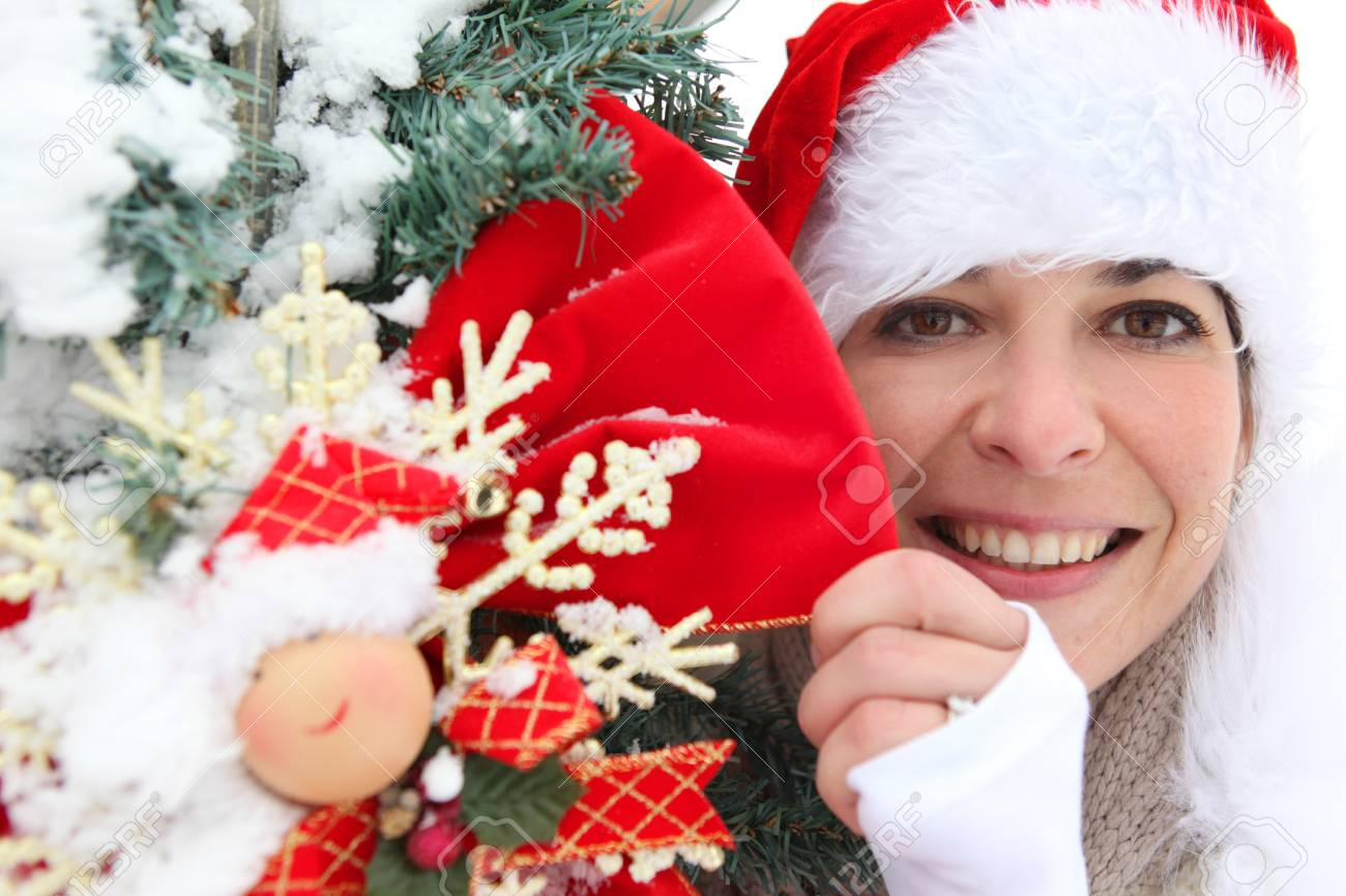 Woman in festive hat holding decorations Stock Photo - 14101327