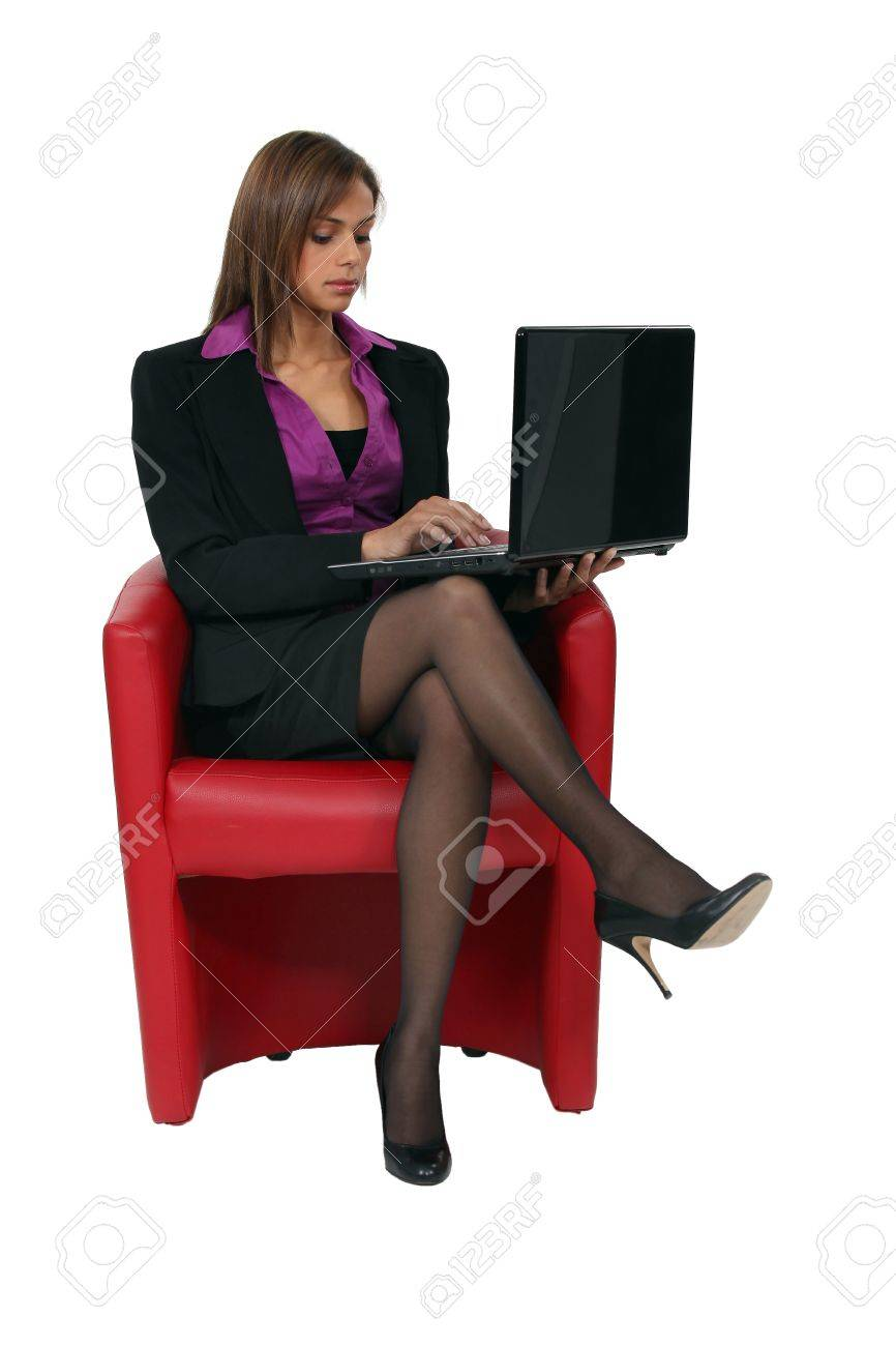 Woman sitting in red chair Stock Photo - 14101799