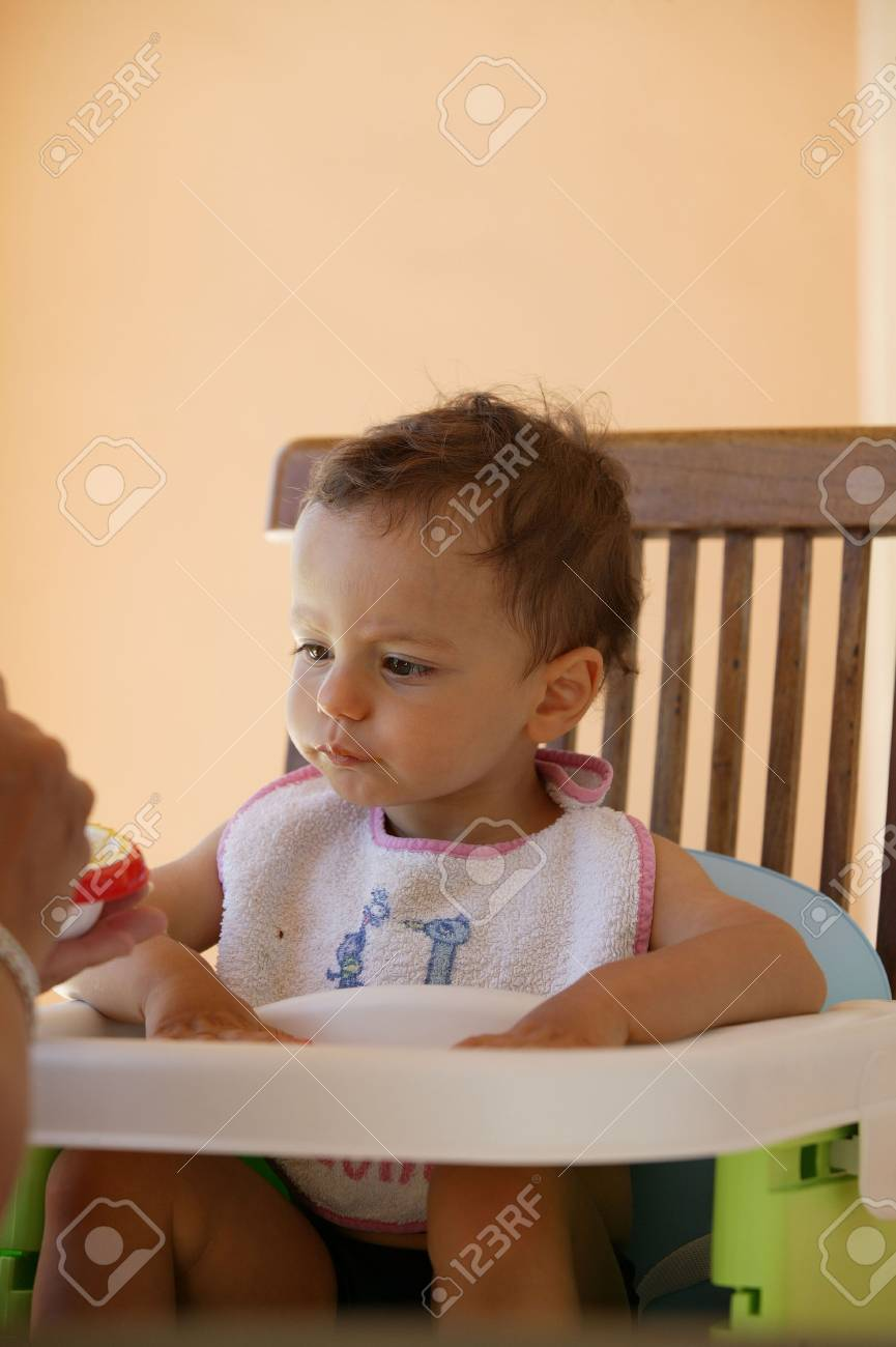 Toddler in high-chair Stock Photo - 14101708