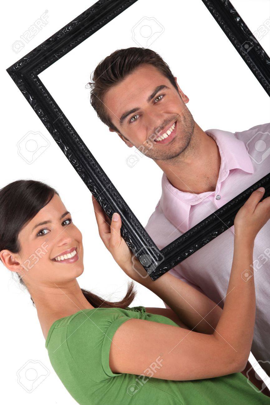 Couple with a picture frame Stock Photo - 14106727
