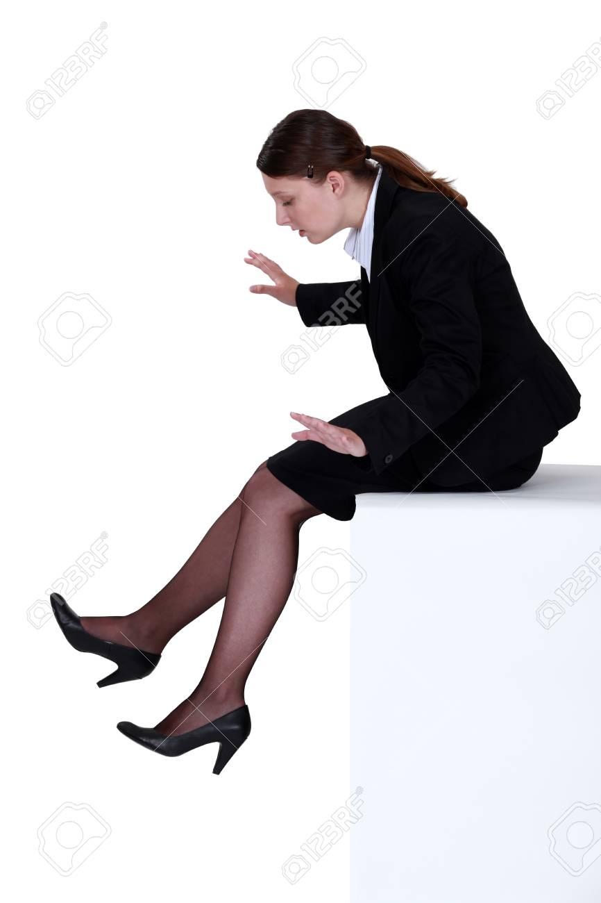 Businesswoman sat on ledge Stock Photo - 14193477