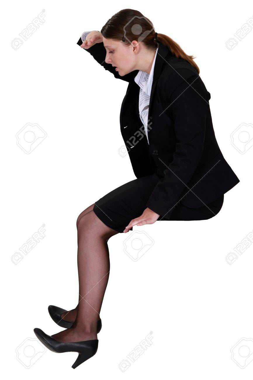 Woman sitting looking down Stock Photo - 14193411