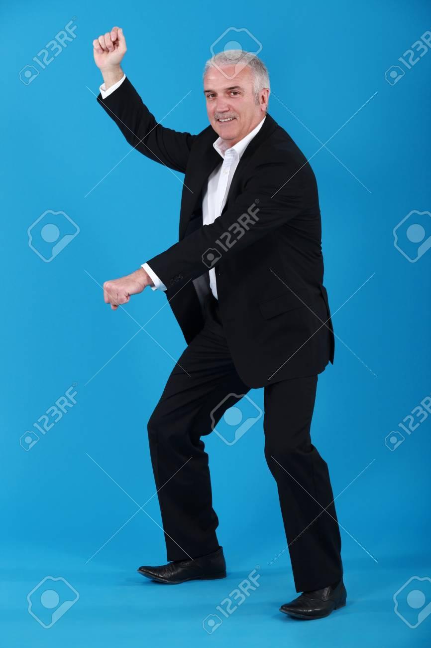 Senior businessman pretending to ride horse Stock Photo - 14195464