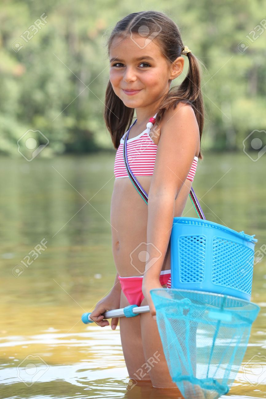 cute little girl fishing in river stock photo, picture and royalty