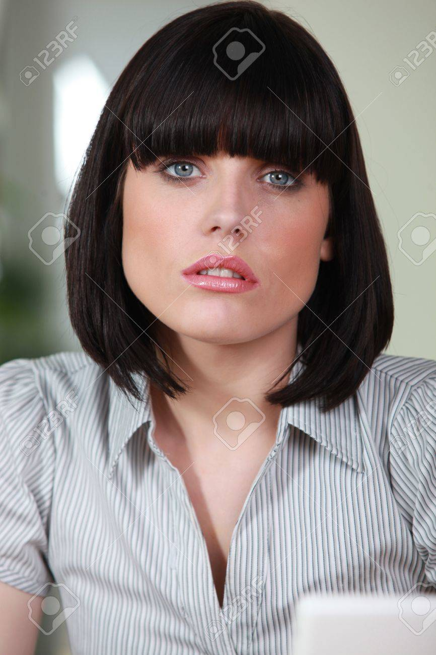 Female office worker with a bobbed haircut Stock Photo - 14213762