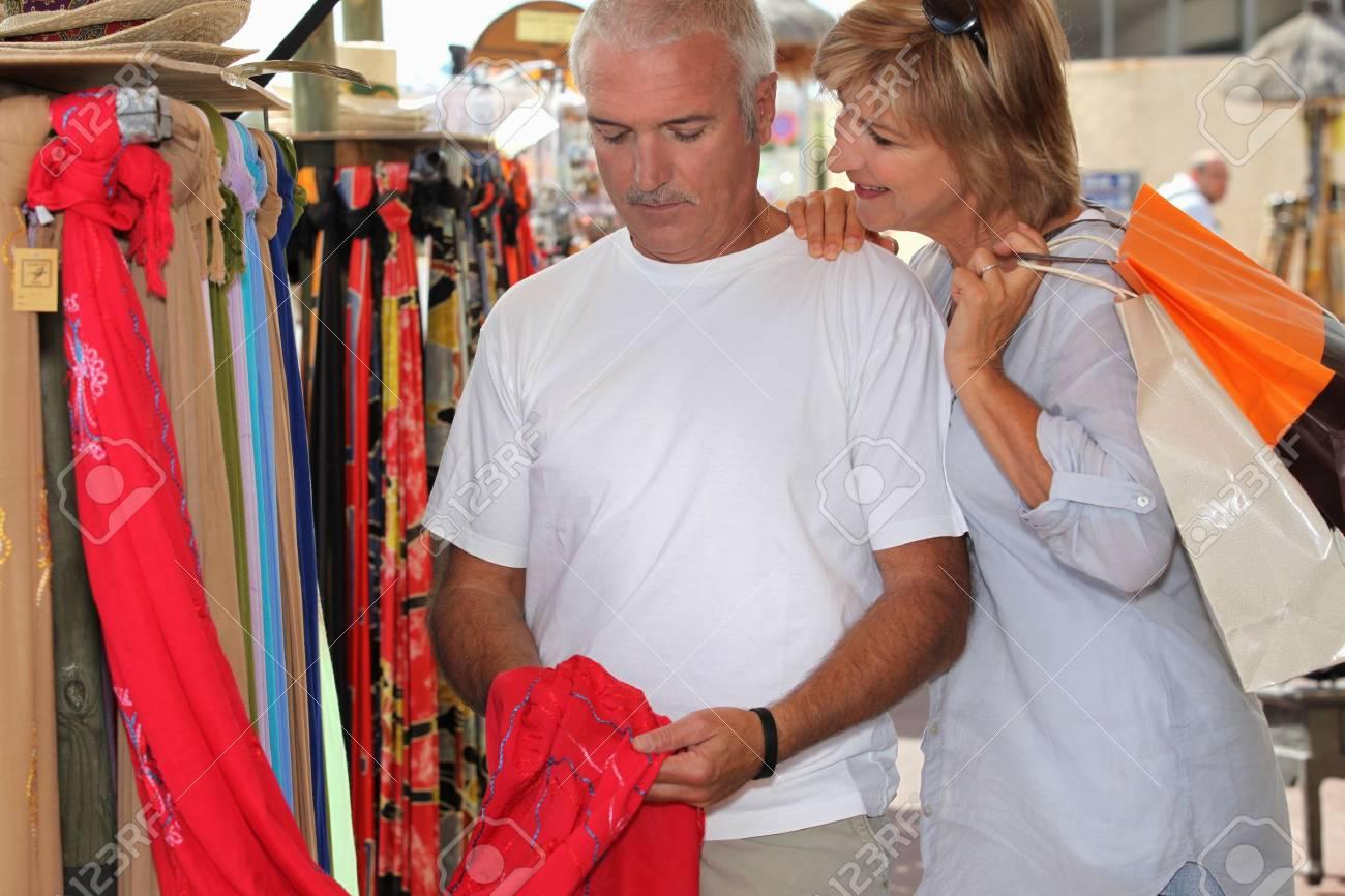 Man and woman at market Stock Photo - 14214159