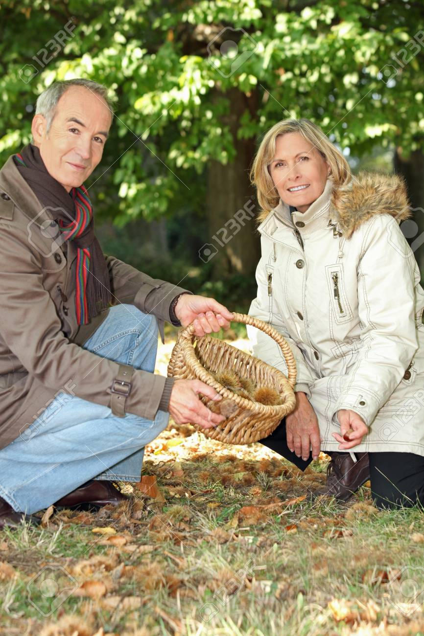 Couple foraging in the woods Stock Photo - 14229855