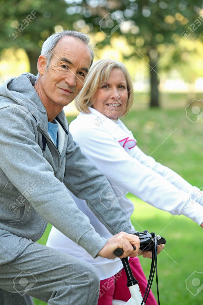 Couple biking Stock Photo - 14203486