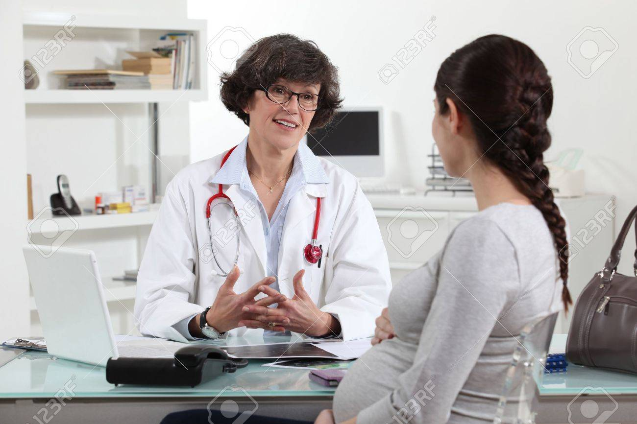 Pregnant woman in doctors appointment Stock Photo - 14205474