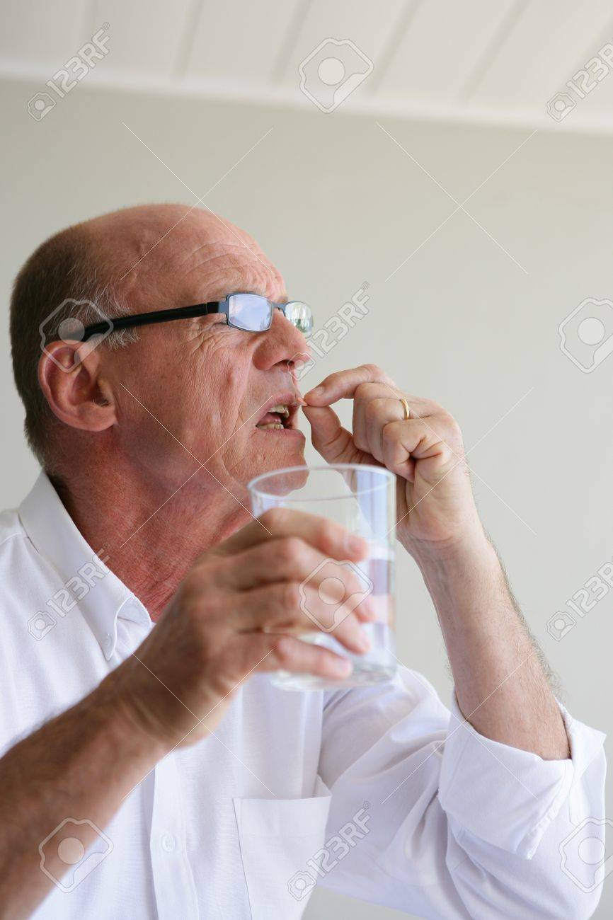 Senior man taking his medicine Stock Photo - 14205065