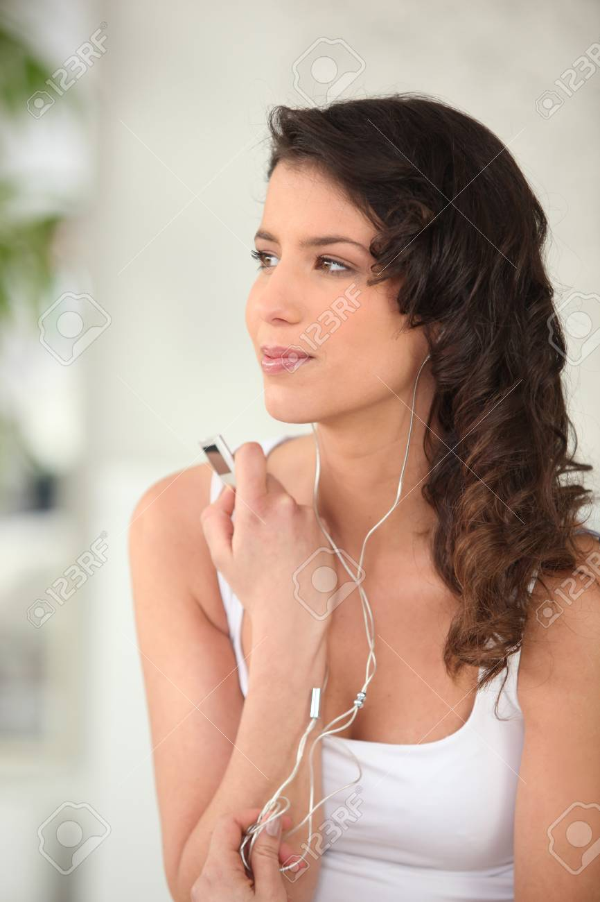 Woman listening to music Stock Photo - 14207531