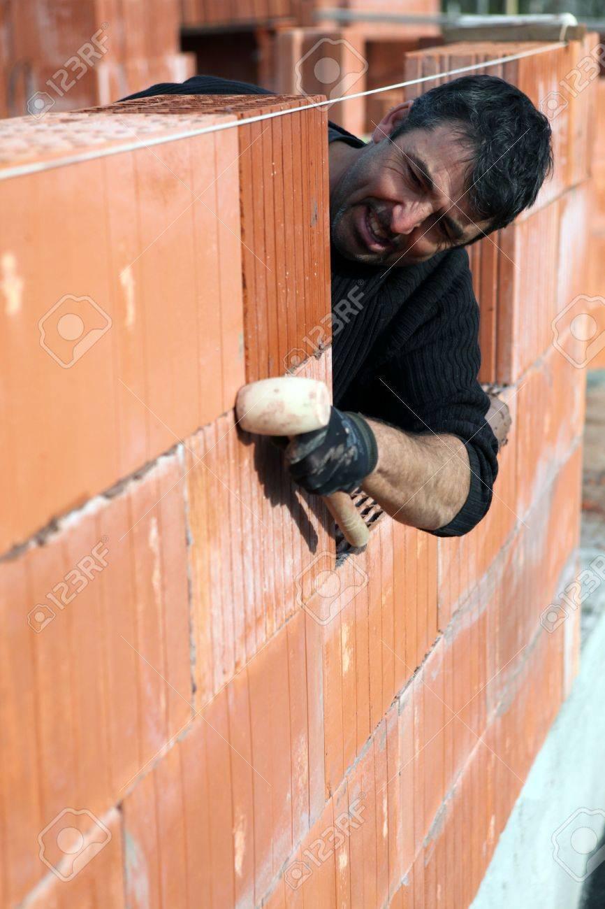 Man Building A Brick Wall Stock Photo