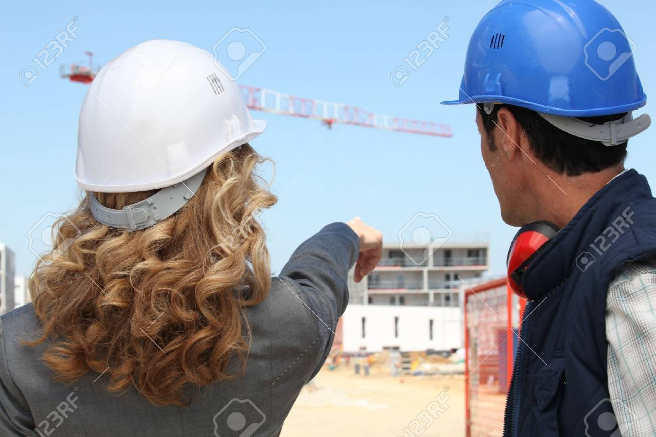 Tradesman and an engineer working together on a construction site Stock Photo - 14214212