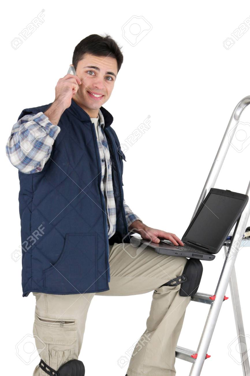 Tradesman posing with his building materials and laptop Stock Photo - 15071895