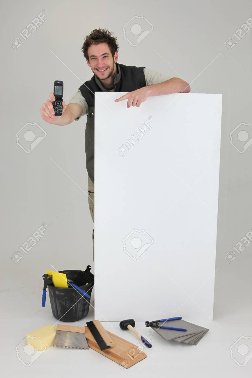 Decorator displaying mobile phone Stock Photo - 15072754