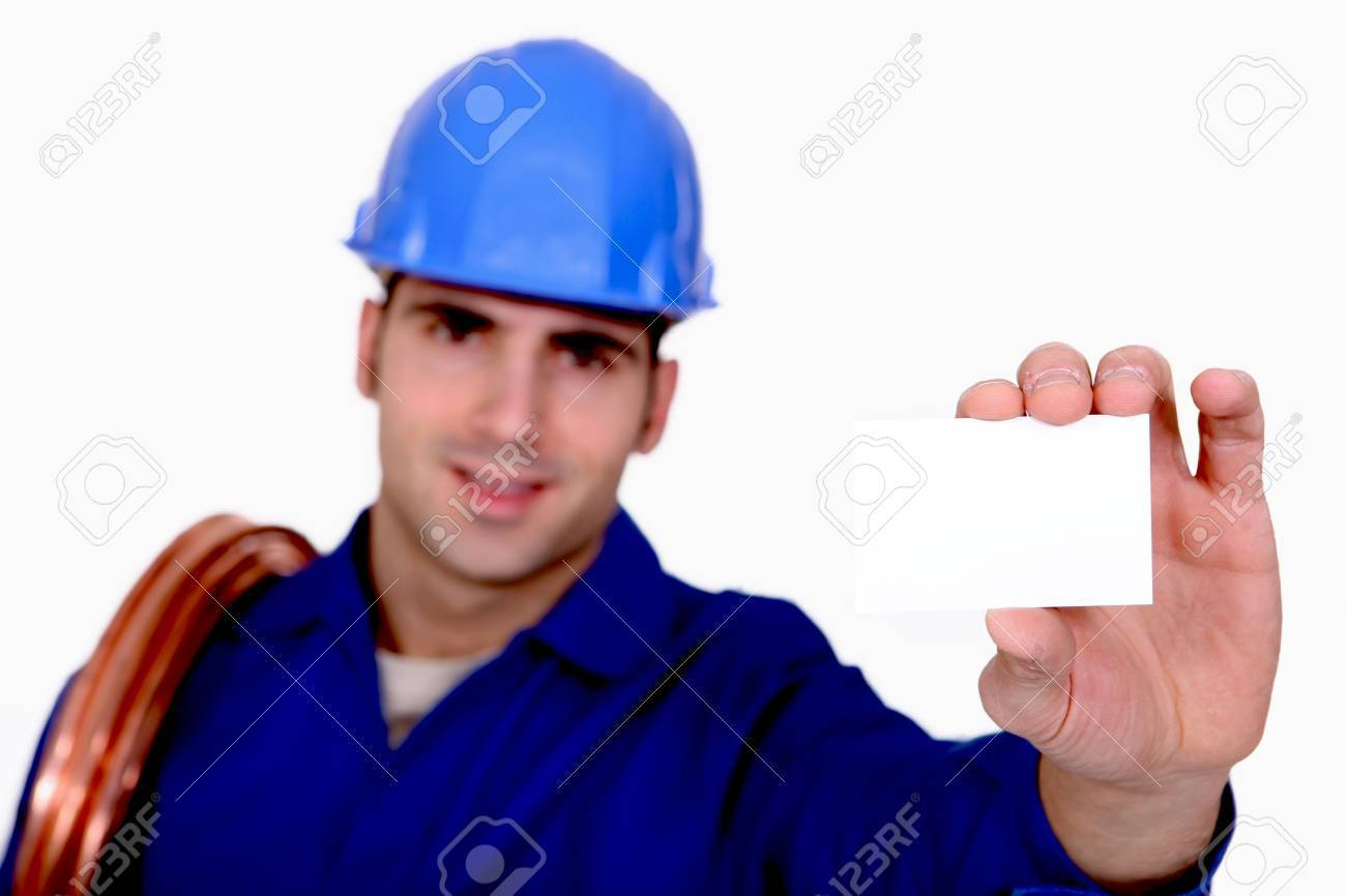 Plumber holding business card Stock Photo - 15072320