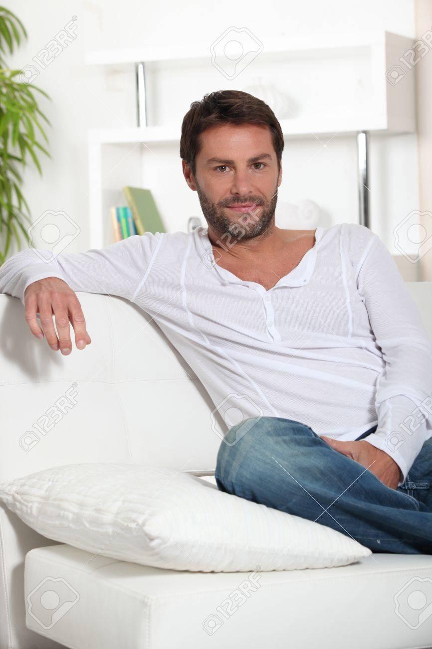 Man sat on sofa Stock Photo - 15496686