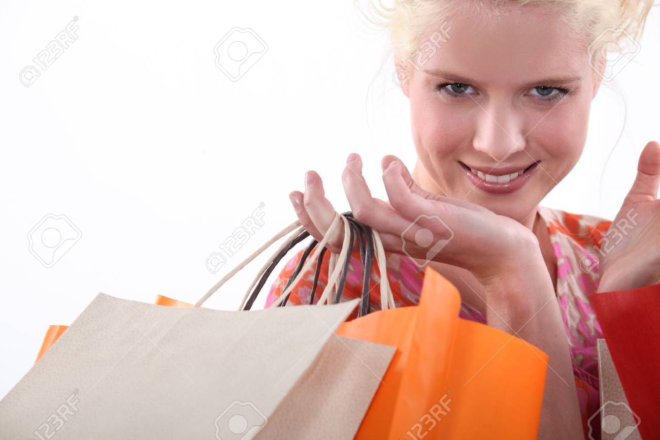 Closeup of a woman with store bags Stock Photo - 15224525