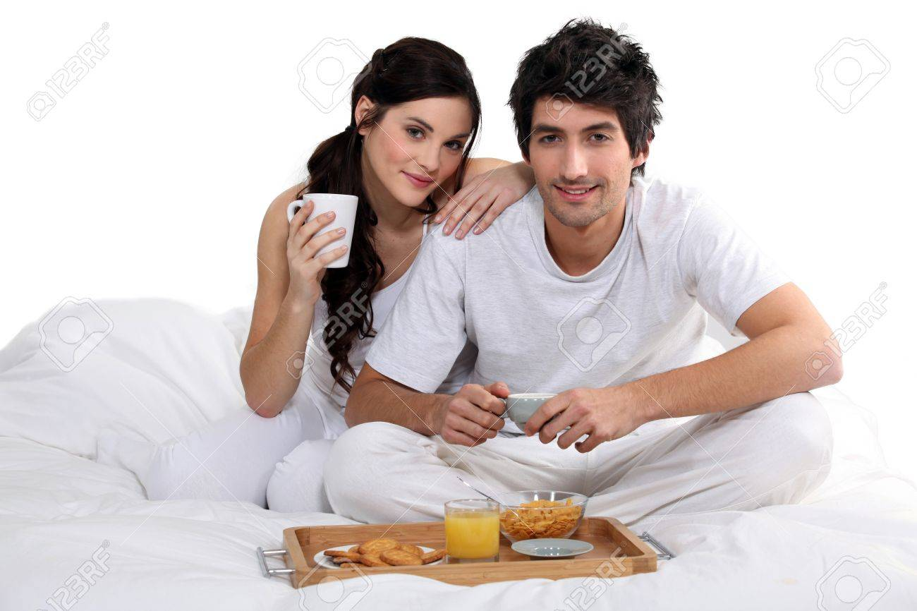 Couple having breakfast in bed Stock Photo - 15234439