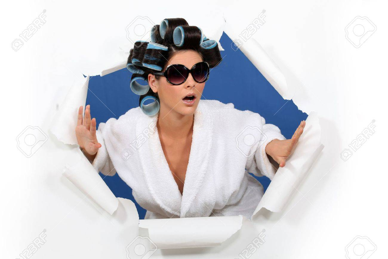 Surprised woman in hair rollers Stock Photo - 15263109