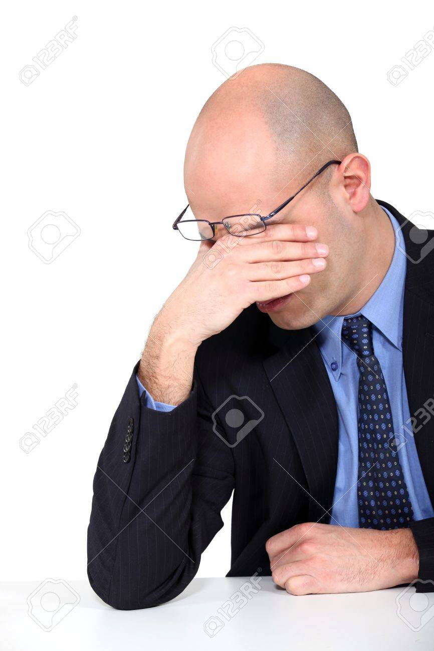 tired businessman rubbing his eyes Stock Photo - 15263117