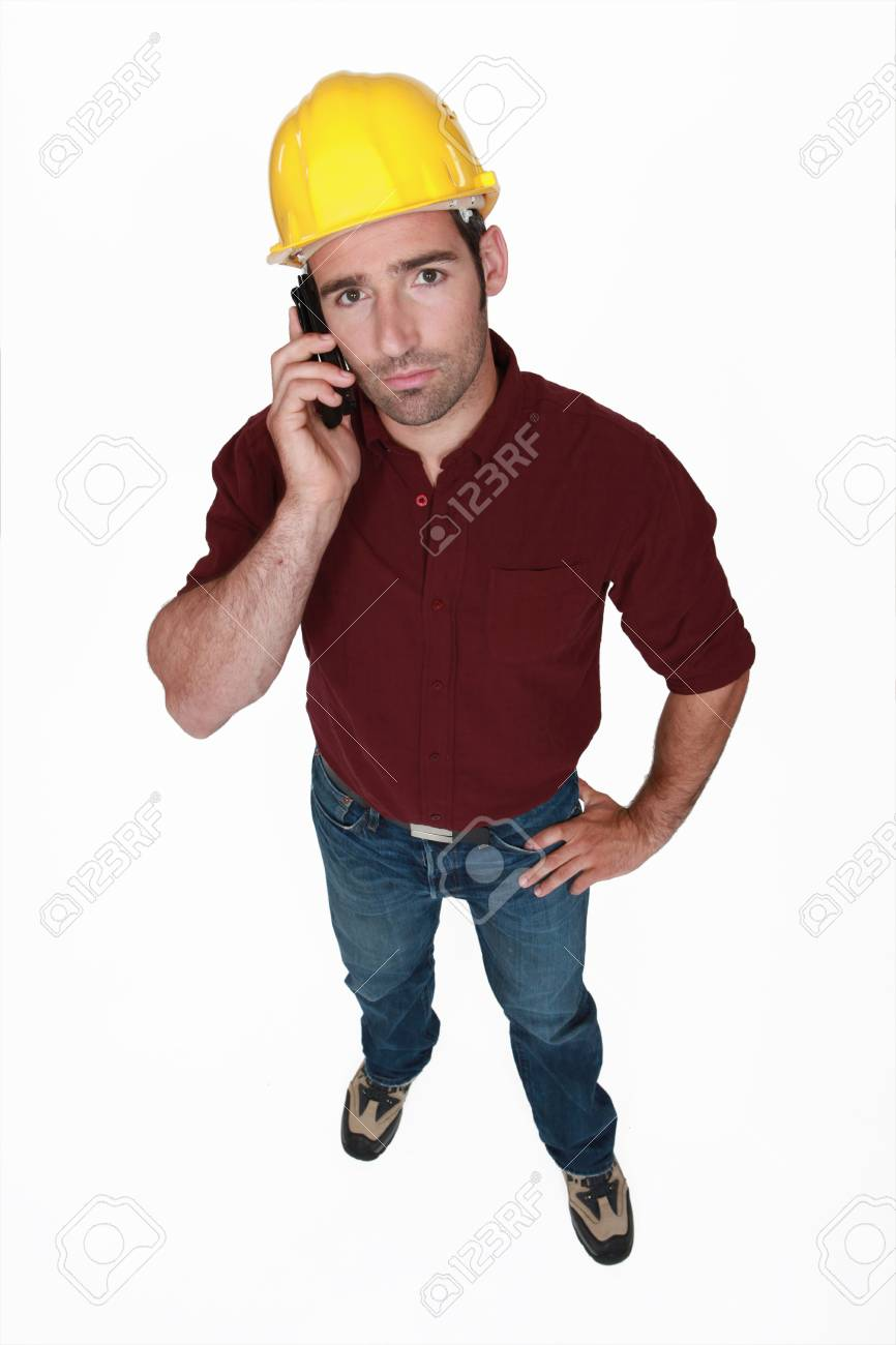 Serious construction worker on the phone Stock Photo - 15263464
