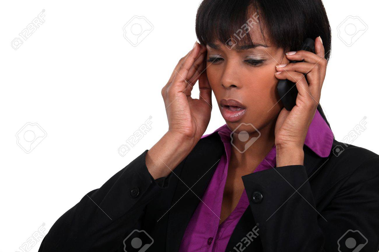 Office worker receiving bad news over the telephone Stock Photo - 15263608