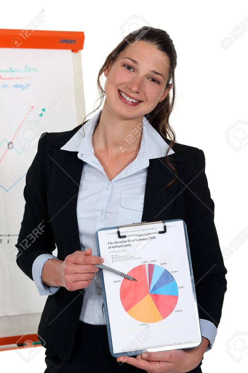 cute young businesswoman showing pie chart during meeting Stock Photo - 15290109