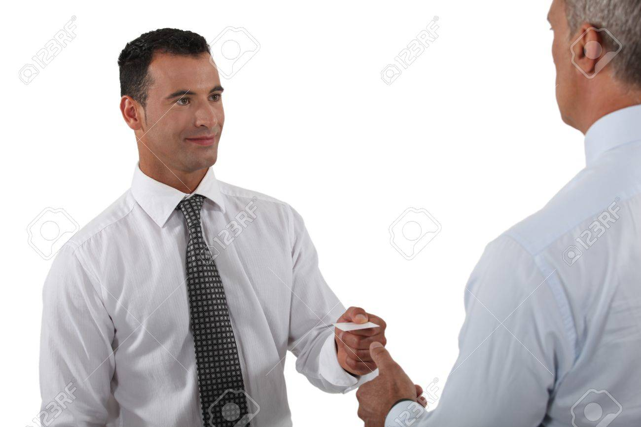 Man handing over his business card to a potential client Stock Photo - 15289883