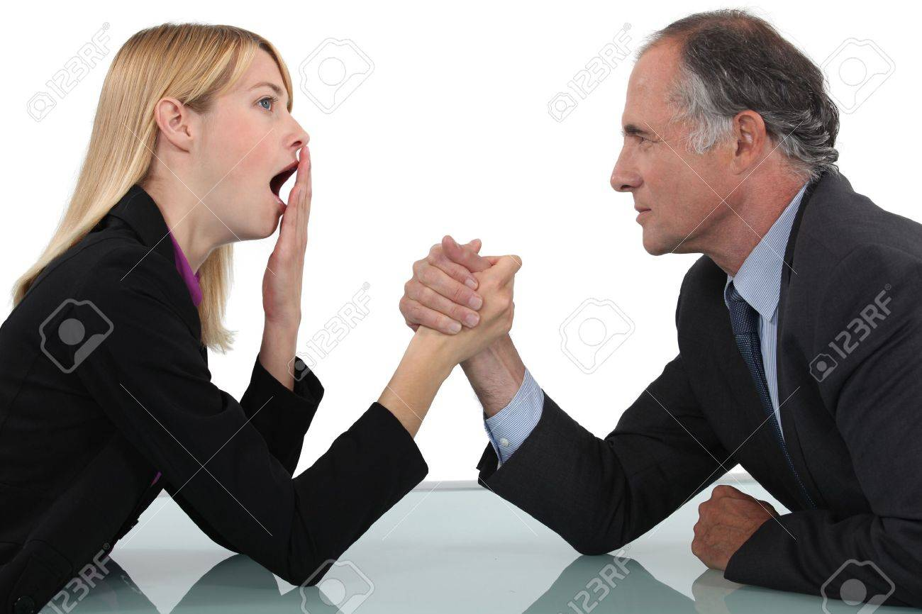 Woman arm wrestling with her boss Stock Photo - 15289997