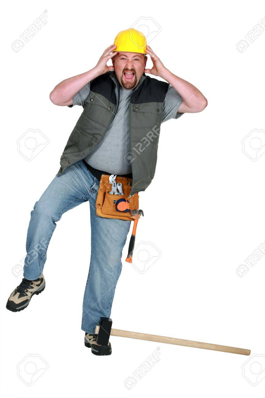 craftsman hurting himself with a hammer Stock Photo - 15289596