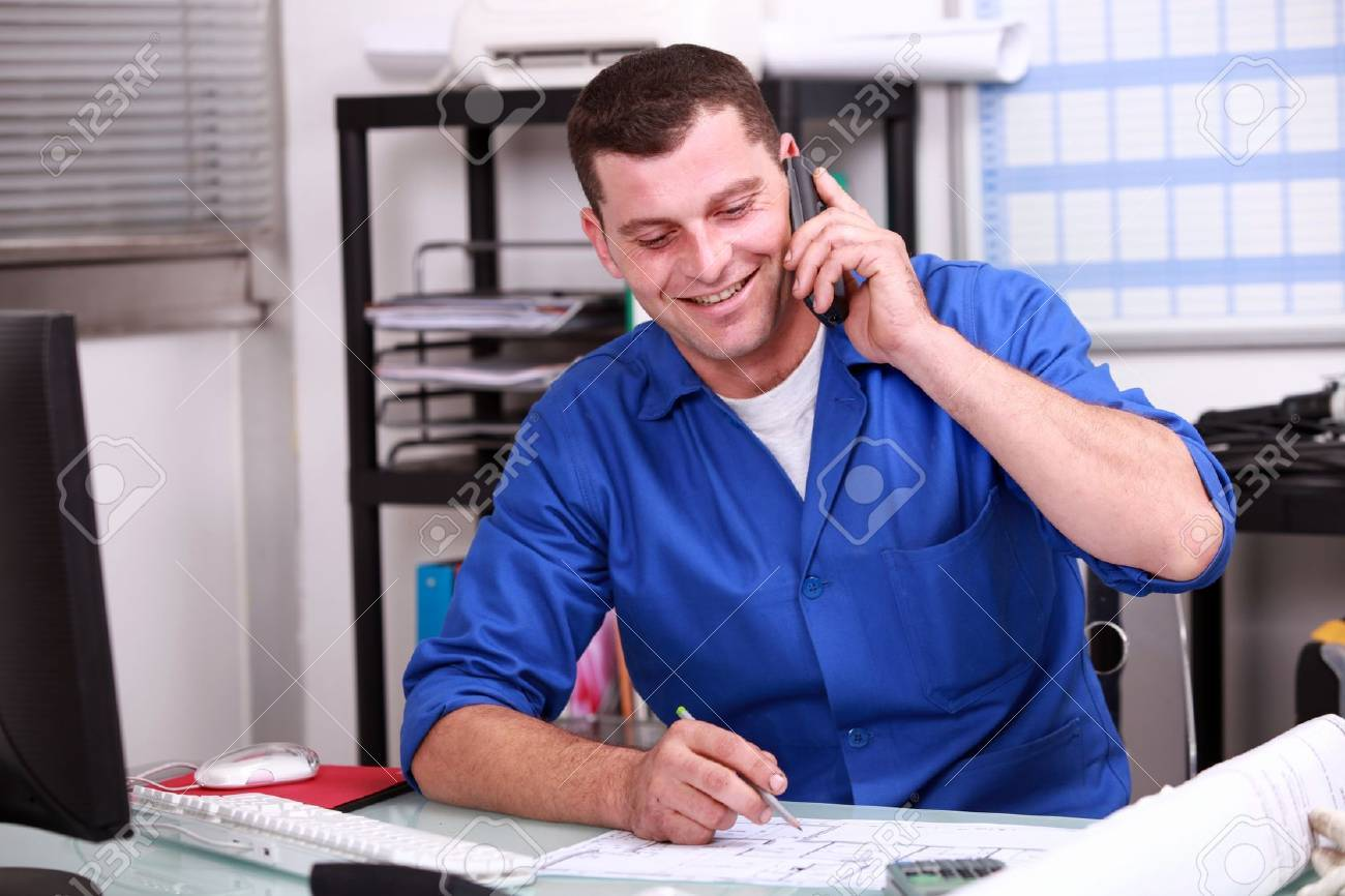 Builder in the office Stock Photo - 15411505