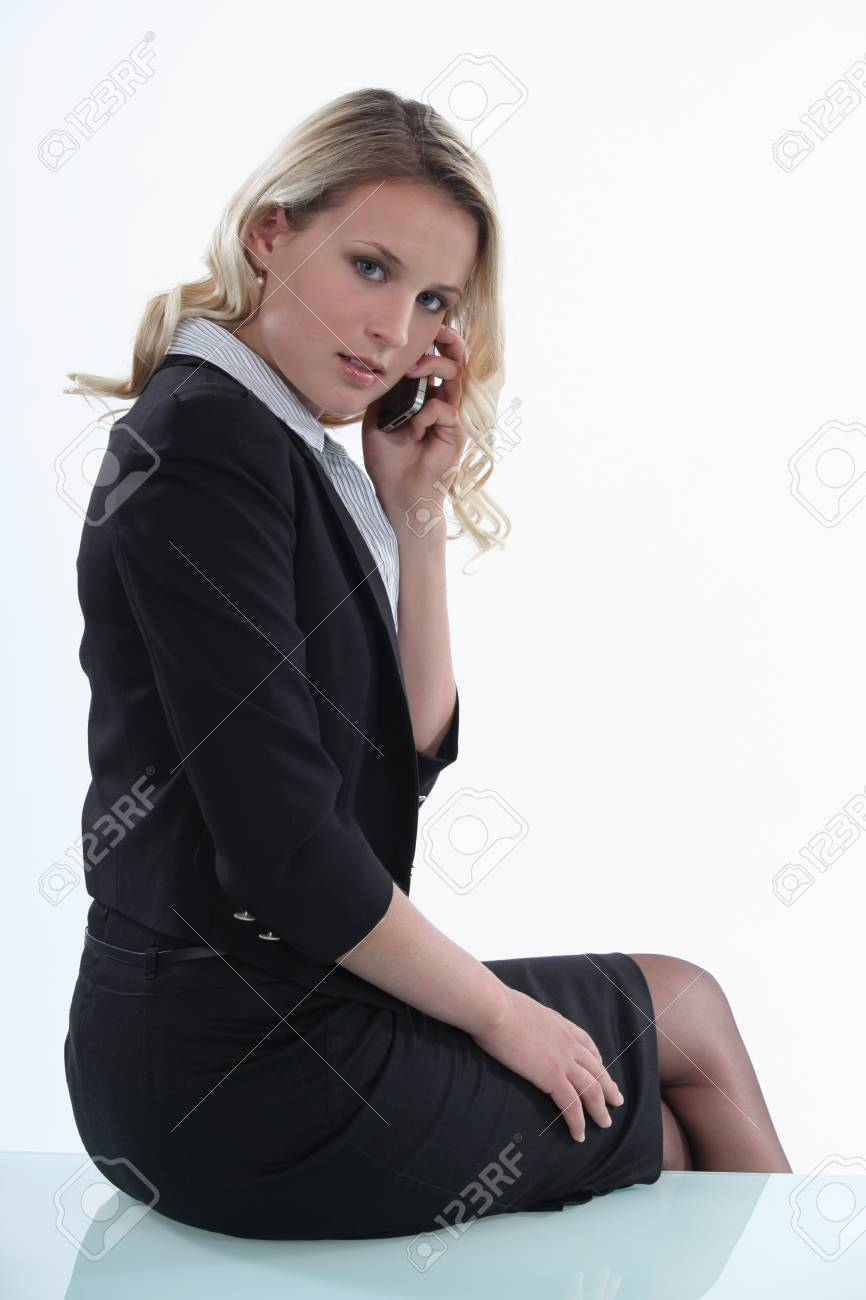 Woman sitting on the table with mobile Stock Photo - 15409464